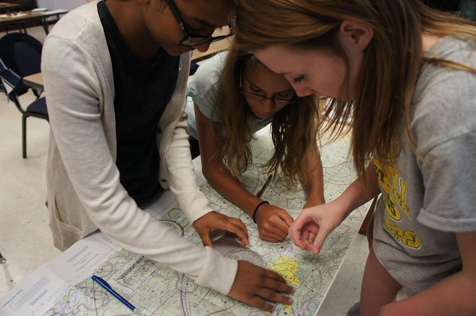 Girls working with maps