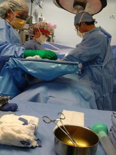 Dr. Willard Campbell of Premier Surgical (right) and two nurses operate on a patient in Guatemala.