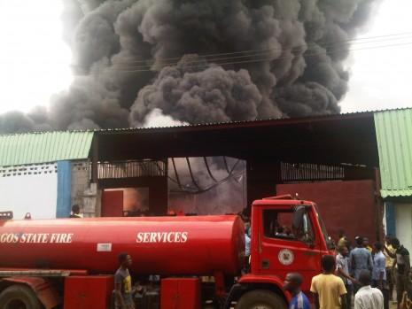 Coscharis warehouse burning behind the walls. Photo: Ben Ezeamalu