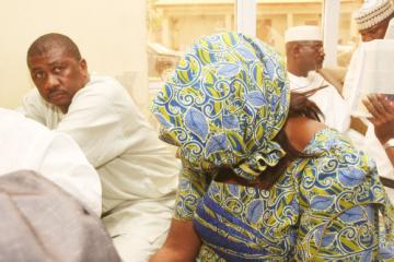 PHOTO NEWS: Suspected pension fund thieves try to hide faces in shame