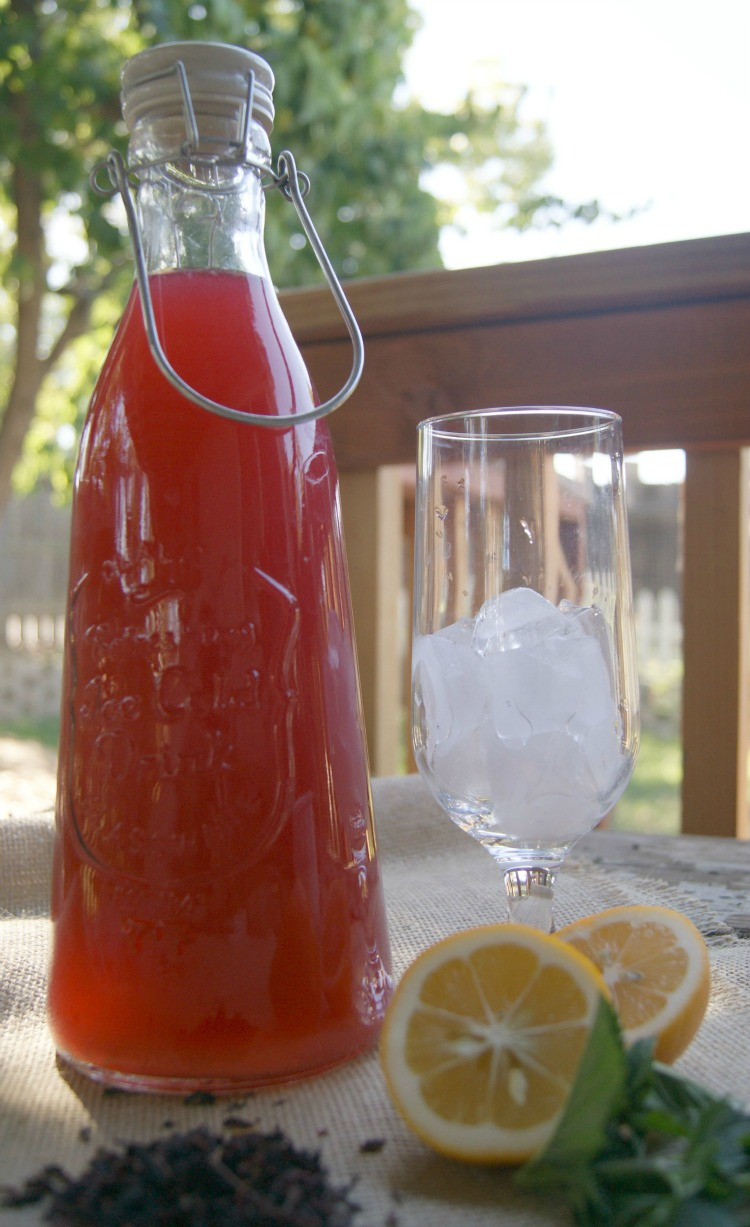Real Food Punch - made with Vitamin C rich hibiscus, sweetened with honey and a touch of lemon. It's a great alternative to corn syrup drinks on the market.