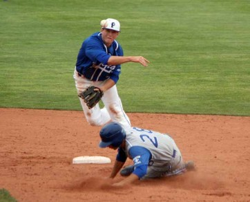 Bub Wilde turns the double play during state tournament play. (Photo by Kurt Johnson)