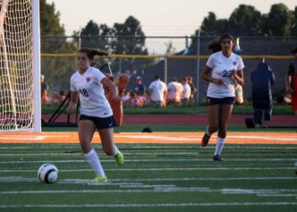 Katie Haskins (18) and Weslee Baird (23) are playmakers from the Timpview defense. (Photo by Kurt Johnson)