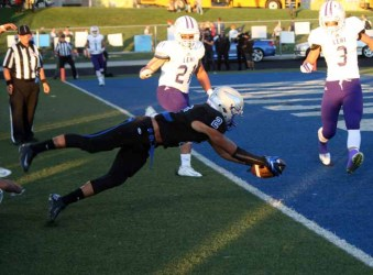 Pleasant Grove's Malik Overstreet dives for the end zone and a Viking TD. (Photo by Kurt Johnson)