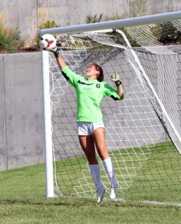 Goalkeeper Megan Turner punches a shot over the cross bar for Brighton. (Photo by Kurt Johnson)