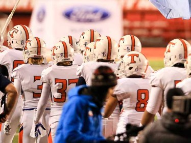 "Timpview players at Rice-Eccles Stadium with the ""B"" on their helmets honoring Baylee Hoaldridge. (Photo by Kevin McInnis)"