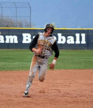 Cottonwood's Oliver Dunn headed for home during April 13 game at Bingham. (Photo by Kurt Johnson)