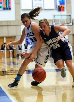 Layton's Livia Borges battles for a loose ball during the state semifinal. (Photo by Kevin McInnis)