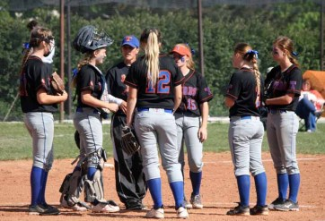 The Timpview softball infield gathers at the pitchers' circle during one of its final games on its current field. (Photo by Kurt Johnson)