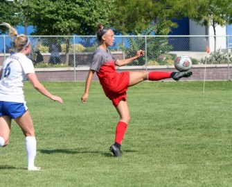 Brecken Mozingo with the one-touch volley chip for an Alta goal. (Photo by Kurt Johnson)