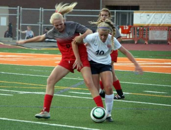 Alta defender Lauren Webb works against Lily Haskins of Timpview. (Photo by Kurt Johnson)