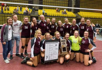 The Morgan High volleyball team with its state championship trophy. (Photo by Ari Davis)