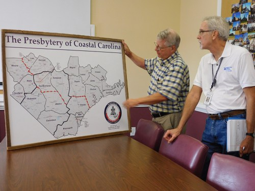 NRT Lead Jim Reinarz and General Presbyter Bill Reinhold review areas hardest hit in Coastal Carolina Presbytery. (Photo by Lynn Nakashian)