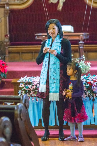 Theresa Cho, co-pastor of St. John's Presbyterian Church in San Francisco leads worship with her daughter, Isabella Kim.