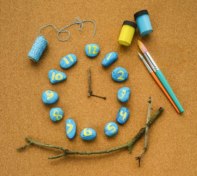 Make a nature-inspired rock clock to teach children math skills and introduce children to telling time