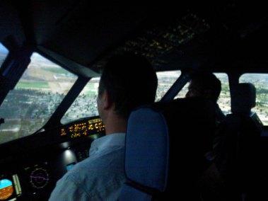 Airport flight information screens for flight simulator service 7