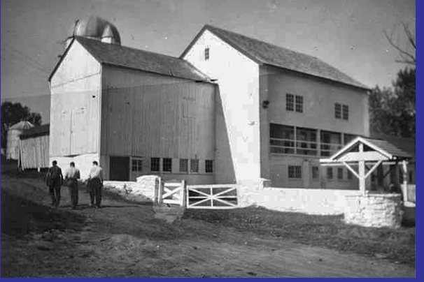 black and white photo shows angled view of completed party barn