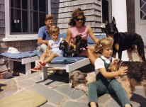 The Kennedy family poses with their dogs at Hyannisport: Irish spaniel Shannon, Welsh terrier Charlie, German shepherd Clipper, and the pups of Pushinka, who was a gift to Caroline from Soviet premier Nikita Khrushchev.