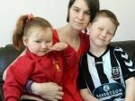 Isla Evans, of Elgin, with her children