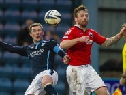Kevin Thomson and Craig Curran challenge for the ball when the teams met earlier this season