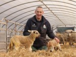 The Texel cross with farmer John Ainslie beside a 'normal size' lamb