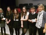 Portlethen Academy pupils Cara Bremner, Jasmine Collett, Craig McLennan and Kirsty Ross handing the cheque over to NEEDS