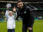 Jay receives his goal of the month award from Celtic's Charlie Mulgrew