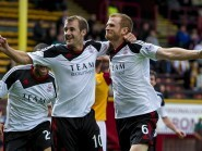Nial McGinn will be up against club team mate Mark Reynolds during the international break