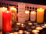Candles burn in memory for those lost in yesterday's  horrific disaster.