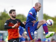 Caley Thistle's James Vincent clears from Dundee United's Nadir Ciftci