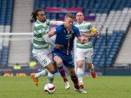 Celtic's Jason Denayer challenges Caley Thistle winger Marley Watkins