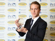 Celtic's Stefan Johansen poses with the PFA Scotland Player of the Year award
