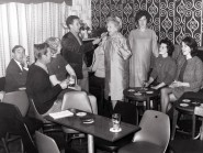 Photograph of the Garlogie Bar in 1967 when Annie Walker from Coronation Street was a the guest personality at the Garlogie Stock Car Racing. (L to R) Annie Walkers Driver/minder, Cameron Ormiston, Annie Mackie,Robbie Shepard, Esma Shepard, Annie Walker, Margaret Allan, Nan Anderson and Olive Ormiston.