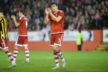 Taylor hoping to led McKenna a helping hand at Dons