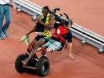 The cameraman on his segway crashes into Usain Bolt