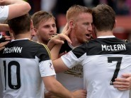 Adam Rooney celebrates his goal with Aberdeen team-mates Kenny McLean and David Goodwillie
