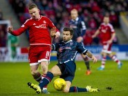 Aberdeen's Jonny Hayes (left) is tackled by Richard Foster