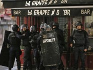 Police officers in Saint Denis, a northern suburb of Paris (AP)