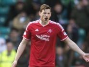 Aberdeen's Ash Taylor is refusing to get carried away after beating Celtic 2-1.