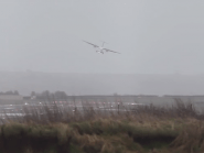 A plane comes in to land at Bristol Airport during Storm Imogen