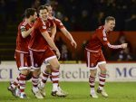 Jonny Hayes (right) celebrates his goal with his team-mates