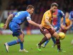 Caley Thistle defender Garry Warren challenges Scott McDonald