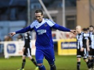Cove's Jonathan Smith celebrates after scoring against Wick