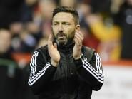 Derek McInnes applauds the Dons fans following last night's win