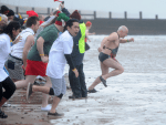 This year's nippy dip raised more than £14,000