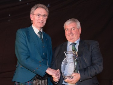 Richard Forsyth, pictured right, receives his lifetime achievement award from Dennis Malcolm