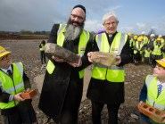 Rabbi Rubin and Monsignor Monaghan are joined by two pupils with the symbolic stones (East Renfrewshire Council/PA Wire)