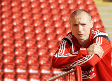 Willo Flood aims to keep Celtic's celebrations on hold