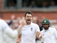 James Anderson celebrates the wicket of Pakistan's Shan Masood at Old Trafford