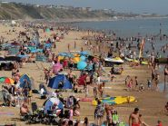 Sunbathers enjoy the hot weather on a busy Boscombe Beach in Dorset